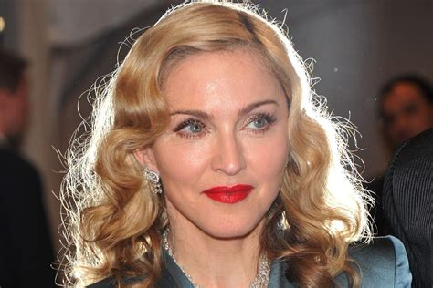Madonna leaves little to the imagination as she strips